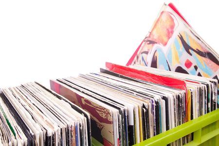 record: Records in plastic boxes on white, closed up Stock Photo