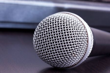 shure: Microphone on black table, closed-up