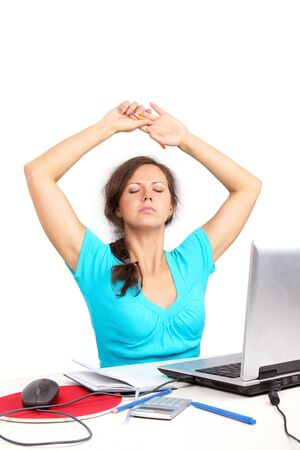 Tired woman sitting in office stretching Stock Photo