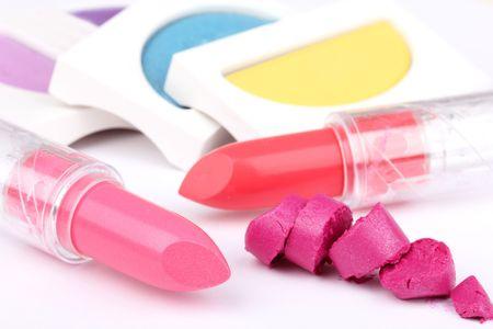 pomatum: Lipsticks and eyeshadows, closed-up on white