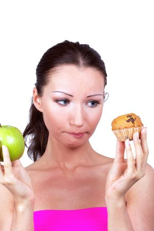 Woman with apple and cake in hands, closed-up portrait Stock Photo - 7373967