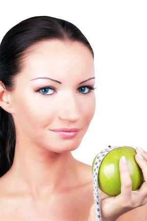 Woman with green apple rounded measuring tape, portrait Stock Photo - 7373955