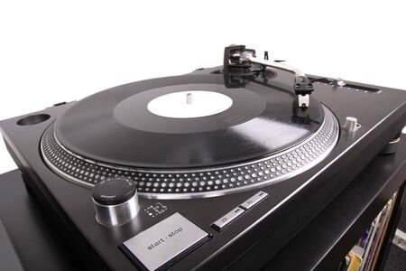 Turntable with needle on record, closed-up on black table photo