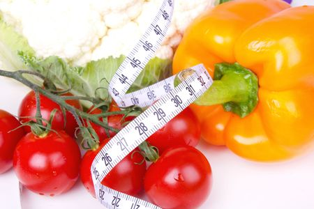 Fresh vegetables rounded by measuring tape, closed-up Stock Photo - 7742001