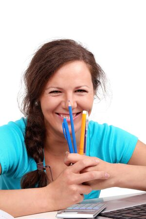 Smilling girl with pens and pencils in hands, portrait on white Stock Photo - 7812974