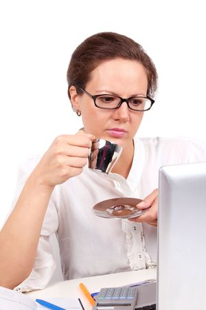 Businesswoman drinking a coffee, sitting in office photo