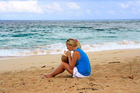 Girl on a beach with coconut photo