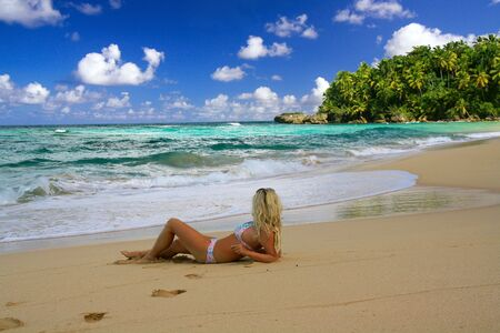 Girl in bikini  on caribbean beach  photo