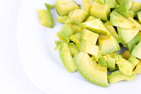 cutted: Cutted avocado on white