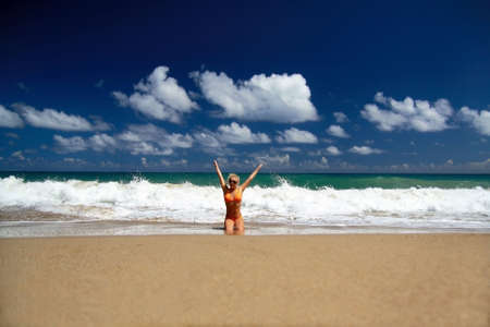 Happy girl on a beach of Atlantic Ocean Stock Photo - 8399130