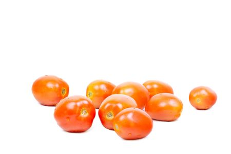 Some fresh red tomatoes isolated on white Stock Photo - 7943385