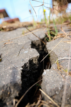 Closed-up cracked asphalt after earthquake  Stock Photo