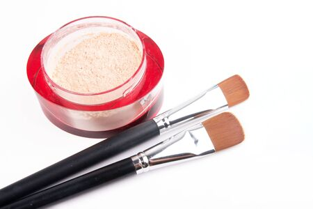 Two make-up brushes and red box with powder isolated on white, closed-up Stock Photo - 7943416