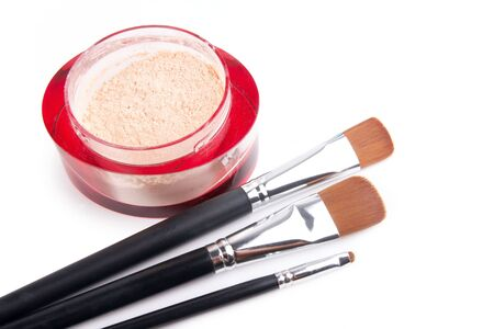 Three professional make-up brushes and powder on white, closed-up Stock Photo - 7943417