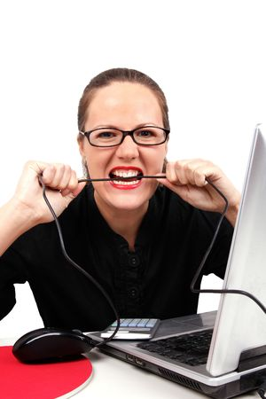 Angry businesswoman biting a cable, portrait on white photo