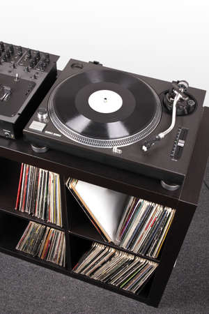 Turntable and Dj mixer on black table,closed-up in studio Stock Photo - 8205230