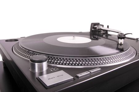 Turntable with dj needle on record, closed-up on black table photo