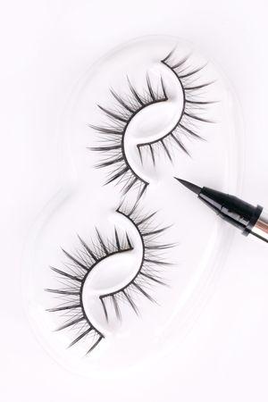 fascicle: Set of eyelashes with eyeliner, closed-up on white
