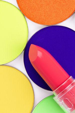 pomatum: Red lipstick on professional make-up eyeshadows, closed-up
