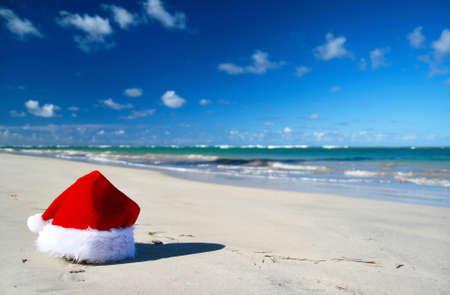 Santa claus hat on caribbean beach, Dominican Republic photo
