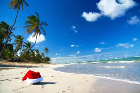Santa hat on caribbean beach photo