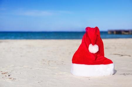 Caribbean Santa Claus hat on beach photo