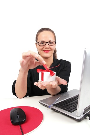 Surprised businesswoman with present box in hand, sitting in office Stock Photo - 8399064