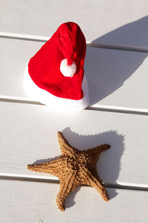 Caribbean christmas hat on wooden table photo