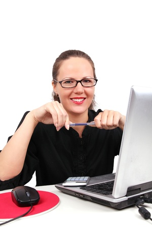 Smilling businesswoman with pen in hands, sitting in office photo