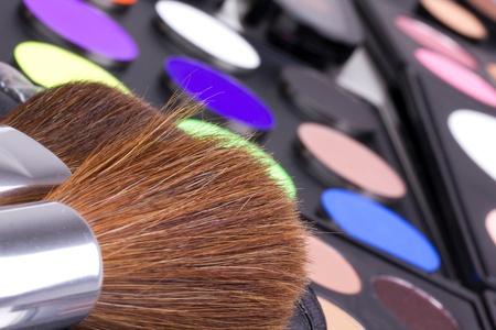 Make-up brushes on eyeshadows palettes, closed-up Stock Photo - 8701603