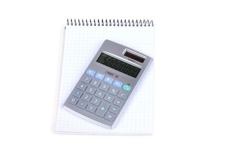 Calculator and notebook with blue pen on white, closed-up photo