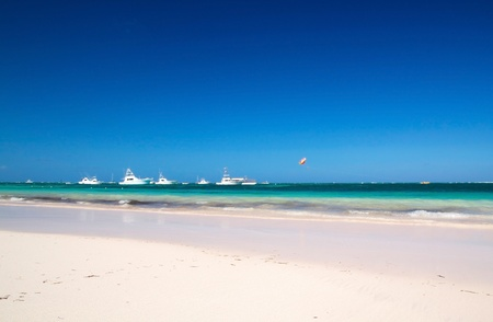 Caribbean beach with yachts, Dominican Republic photo