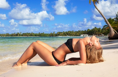 Sexy woman relaxing on caribbean sea photo