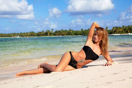 Sexy woman relaxing on caribbean beach photo