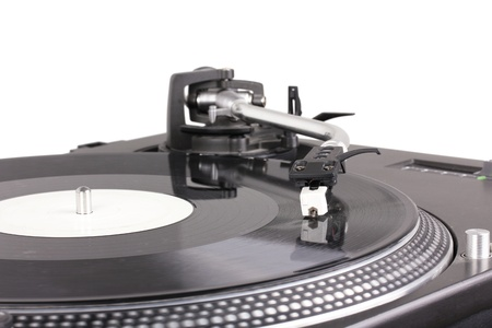 Turntable with dj needle on spinning record, closeup  Stock Photo