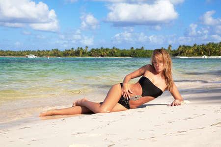 Sexy woman on caribbean beach photo