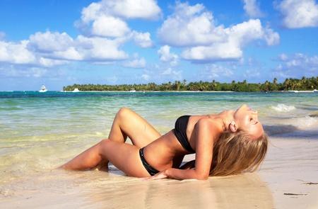 beach model: Woman in bikini on caribbean beach