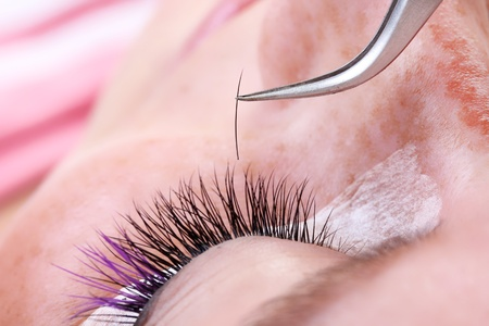 Lash making process, extreme long lashes and tweezers, close-up
