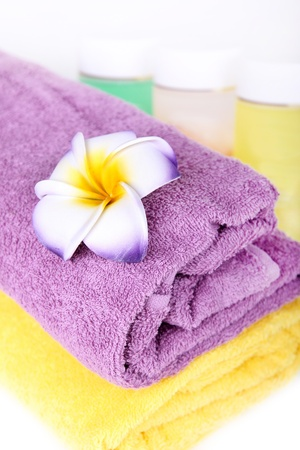 Towels, flower and cosmetics. Beauty spa concept photo