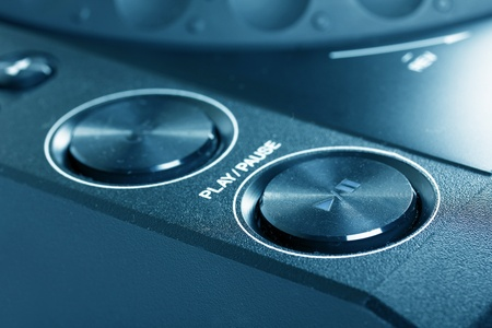 Play and stop buttons on Dj cd player, closeup  photo