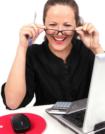 25 to 30: Smilling businesswoman with glasses in hands, sitting in office Stock Photo