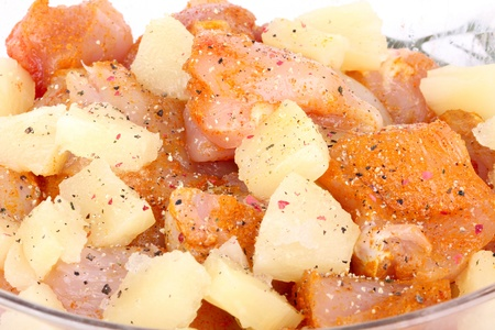 Cutted chicken  fillet with pineapple pieces, closeup photo