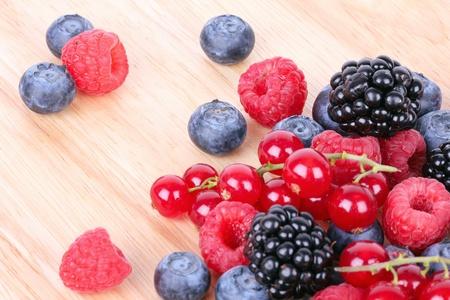 Berries on wooden mat, closeup photo