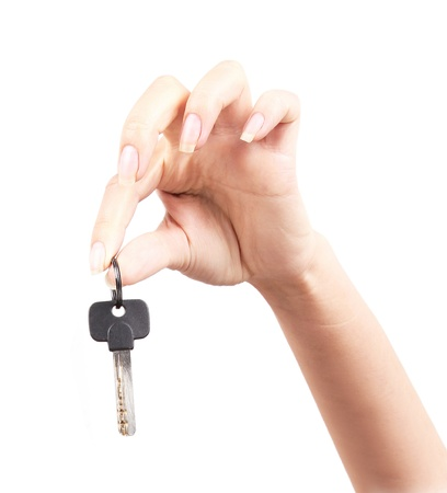 Woman with key, focus on hand with  key photo