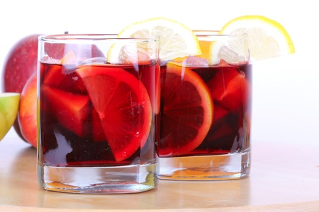 Sangria in glasses on wooden board, closeup photo