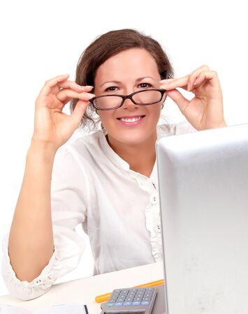 Happy businesswoman on a workplace, closed-up portrait Stock Photo - 10452293
