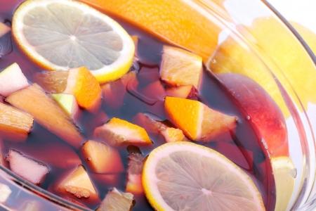 Sangria in glass bowl, closeup shot photo