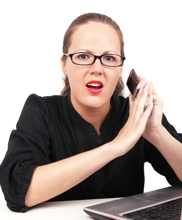 Surprised businesswoman in office, closing mobile photo