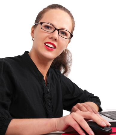 Secretary in glasses in office, working on a laptop photo