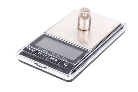 Digital scales with weight on it, isolated on white  photo
